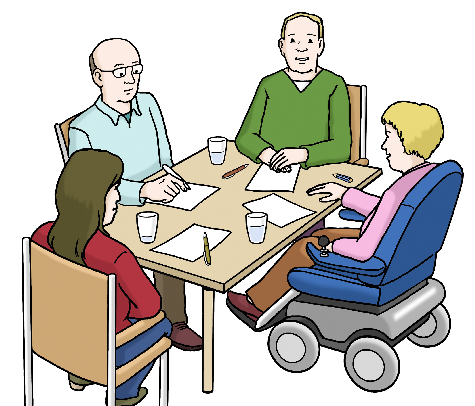 Das Bild zeigt zwei Frauen und zwei Männer, die an einem Tisch sitzen. Eine Frau sitzt im Rollstuhl. Auf dem Tisch liegen Papiere und Stifte.