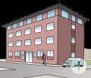 Das Bild zeigt ein Bürogebäude.