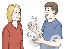 Das Bild zeigt eine Frau und einen Mann. Der Mann spricht gerade in Gebärdensprache mit der Frau.